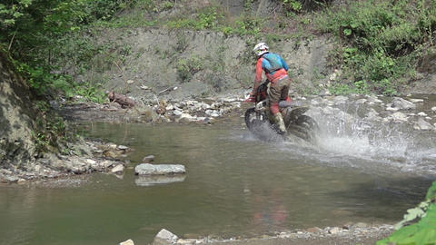 Motocross Rider Crosses the River. Slow Motion Footage