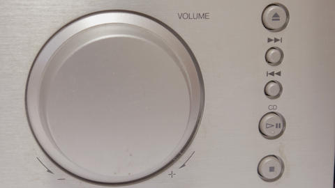 Turning a volume knob 4K Live Action