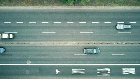 Low altitude aerial top down view of city highway with bus lanes Live Action