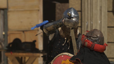 Slow motion video of of two fencing armored warriors with a hits and missed Live Action