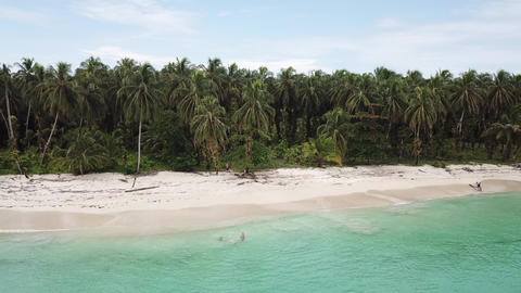 Aerial shot flying of desolated island with jungle in Panama Live Action