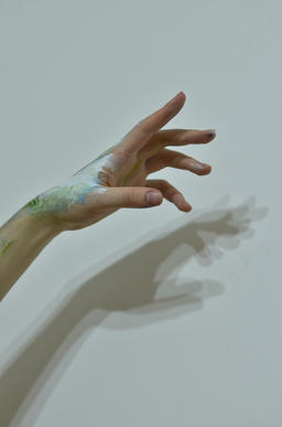 Beautiful Woman Hand With Mysterious Psychedelic Painting On White Wall Photo