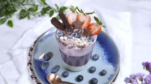 blueberry smoothie milkshake with oat meal and cookies. Healthy vitamin diet Live Action