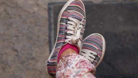 Young woman legs in pink sneakers swinging Footage