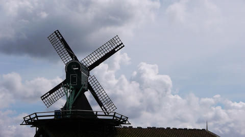 Small wind mill silhouette and dramatic sky Footage