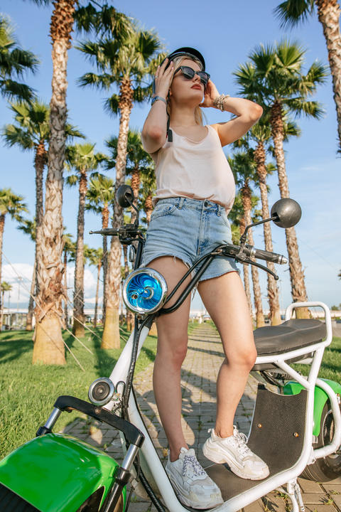 Tourist female taking a tour to exploring around town using electric bicycle Photo