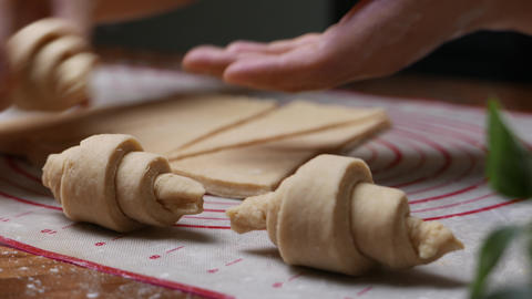 pastry chef pastry chef hand making croissant on wooden board Live Action