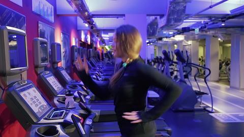 Attractive Caucasian Girl Running on the Treadmill Footage