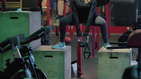 Young Woman Exercising at Gym Footage