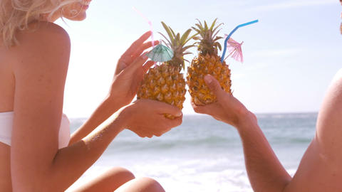 A couple is drinking their pineapple cocktail Live Action