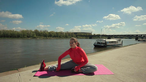Young Brunette Woman Practicing Yoga Near River Footage