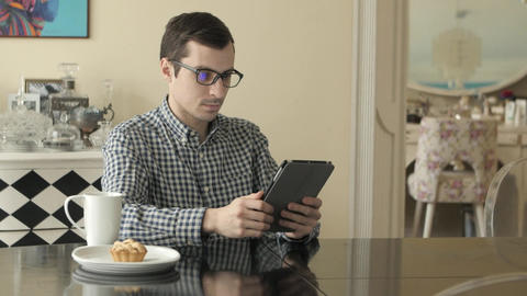 Young Man with Tablet Computer in Home Footage