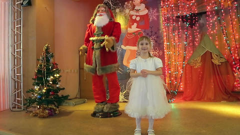 Little girl is photographed with artificial Santa Claus Footage