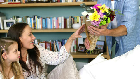 A man offering a bouquet to his wife Footage