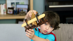Boy playing with a toy plane Footage