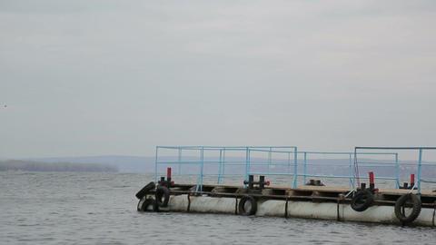 Sad pensive man walks on the pier and walks to the edge Footage