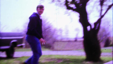1968: Dad pitching boy baseball practice in rural farm country Footage