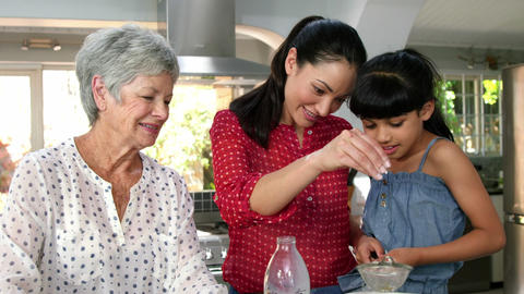 Little girls, grandma and his mom preparing cake Live Action