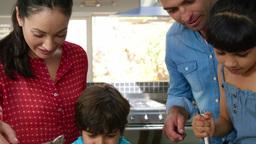 Children preparing a cake Footage