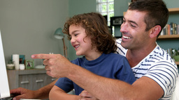 Boy and dad laughing Stock Video Footage