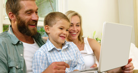 Parent and his son looking at tablet computer Live Action
