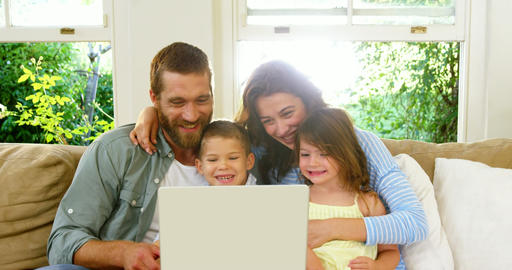 Family looking at the tablet computer Live Action