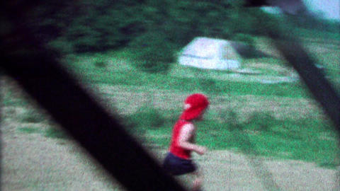 1967: Toddler boy throws baseball run imaginary bases farmland sports Footage