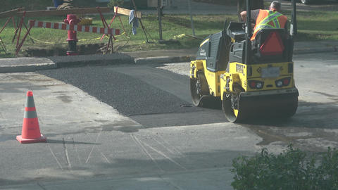 Road roller flattens and smooths out asphalt Footage