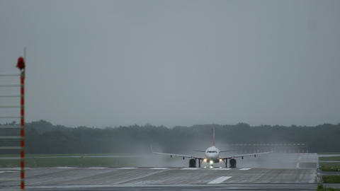 Airbus A320 of Air Berlin take off from wet runway Footage