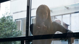 "Young Woman Behind Glass Gestures ""Come"" 영상물"
