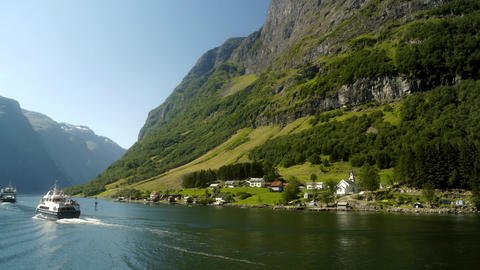 Ship Passing Beautiful Small Town in the Fjords of Norway Live Action