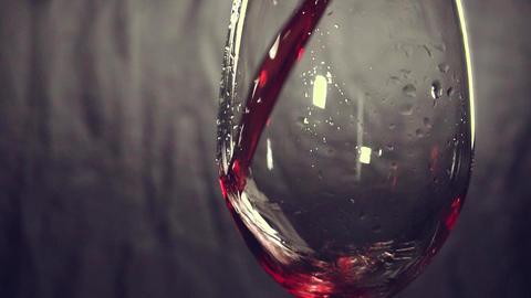 slow motion, pouring wine, glass, dark background GIF