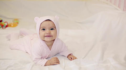 Little beautiful baby girl in pink bear costume Footage