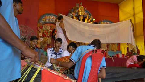 "Hindu priests feeding Goddess Durga - ""vog"", Durga Puja festival celebration GIF"