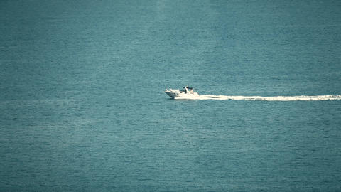 High speed motorboat moves at sea Live Action