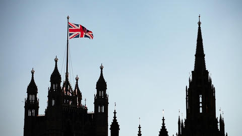 The United Kingdom Flag Over The Palace Of Westminster Footage