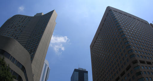 Buildings and blue sky in the commercial district at west Shinjuku ビデオ