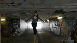 Dancer on a Handrail in Underground Passageway Footage