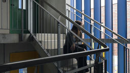 Portrait of a Young Woman Sitting on Staircase Footage