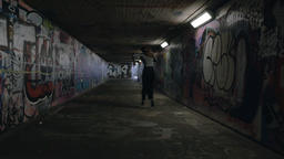 Young Woman Dancing Wildly in an Underground Passageway Footage
