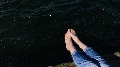 Beautiful female legs on the pier near the sea 영상물