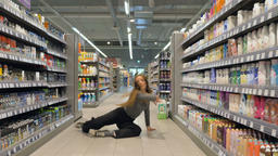 Female Street Dancer Dances in a Grocery Store Aisle Footage