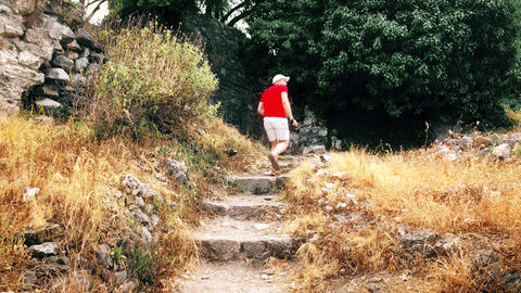 Man in red tshirt takes landscape photos with his camera on vacation GIF