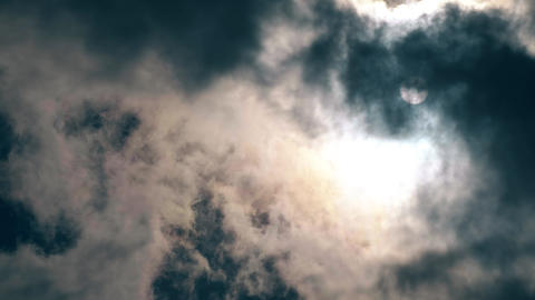 Time lapse of stormy clouds and sun in the sky Footage