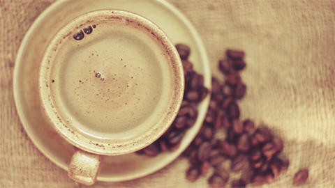 Cup of coffee with coffee beans Archivo