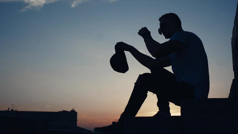 Silhouette Of A Man In The City At Sunset 2