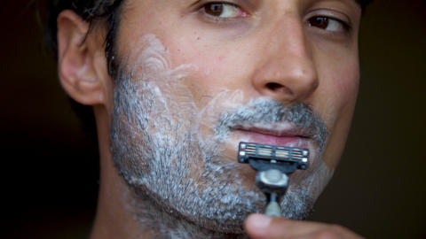Face of the man during shaving Beard is processed by foam for shaving Hair on Footage