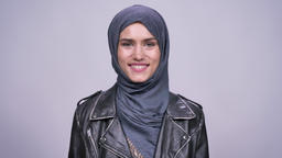 gorgeous smile of caucasian woman in hijab in front of camera with natural sight Archivo