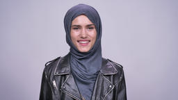 portrait of pure and jolly caucasian girl in hijab laughing and smiling Footage