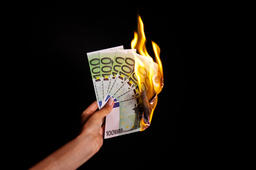 Beautiful Woman Hand Holding Burning Euro Currency Paper Money On Black Wall Fotografía